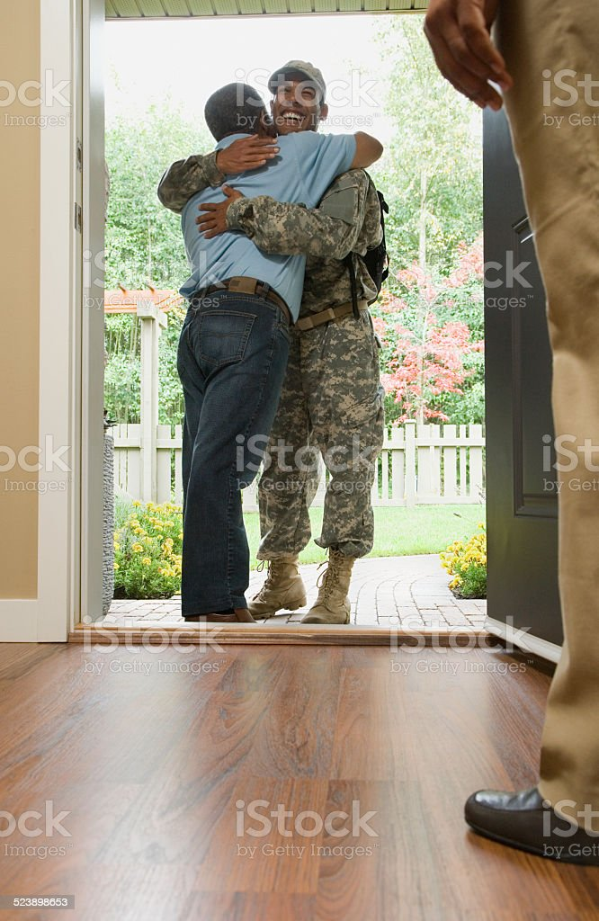 Father Hugging Returning Soldier stock photo