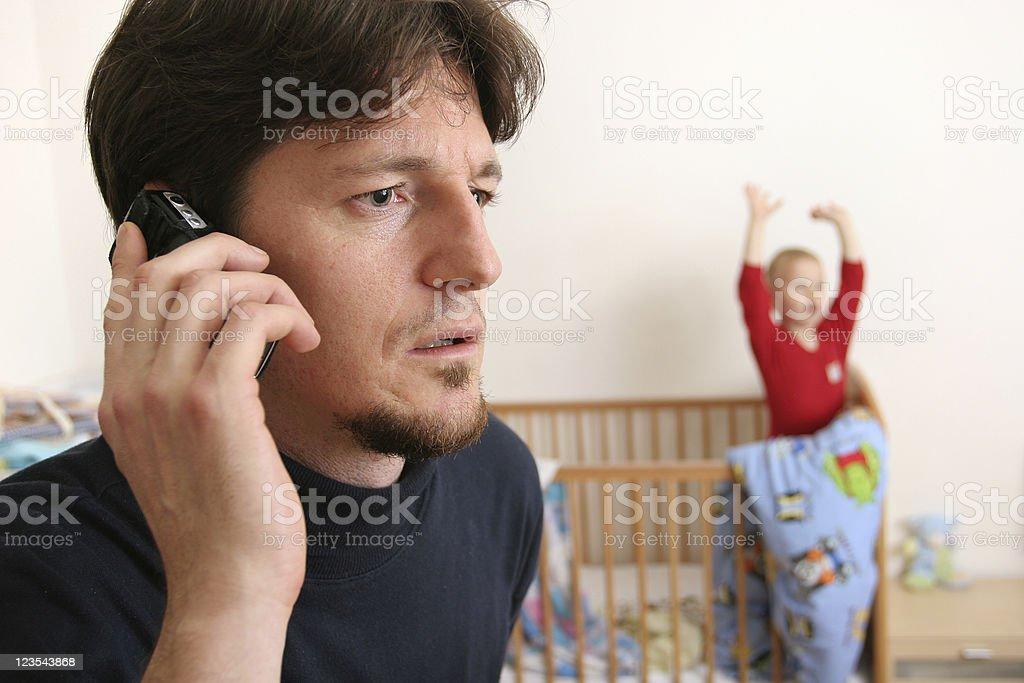 Father ignoring child stock photo