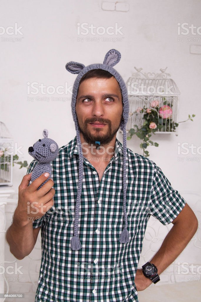 Father in a children's knitted hat with a toy stock photo