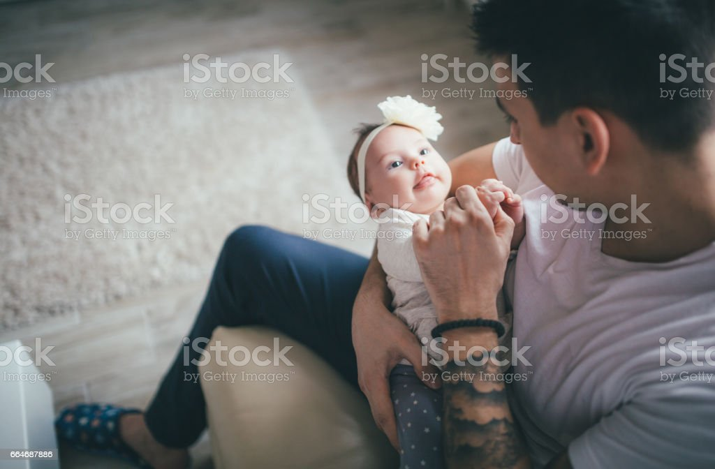 Father is playing with daughter stock photo