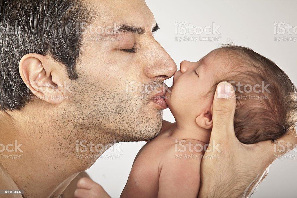 Father kissing newborn royalty-free stock photo