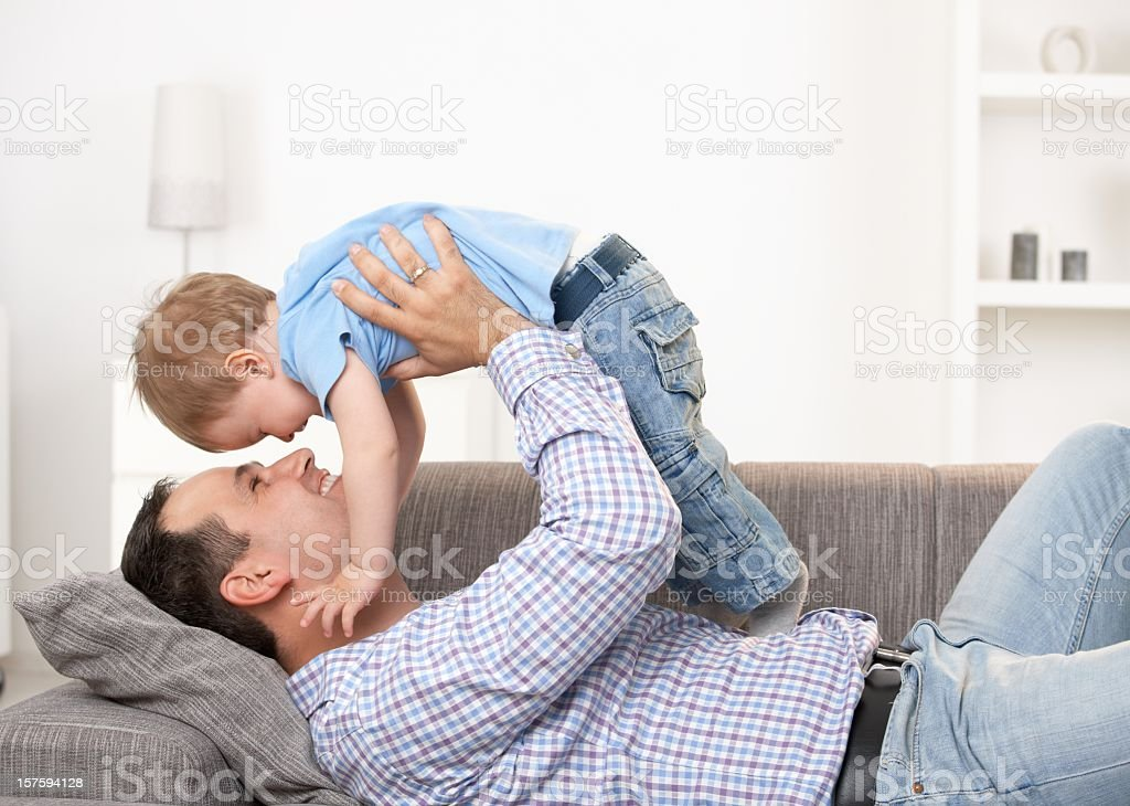 Father lifting baby royalty-free stock photo