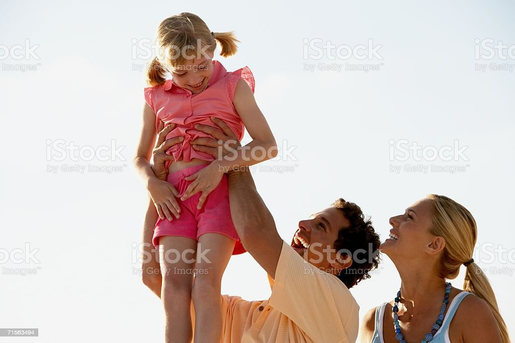 Father lifting daughter royalty-free stock photo