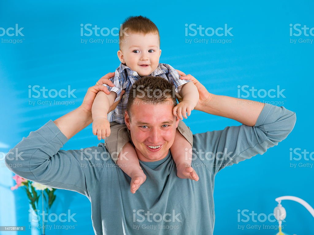 Father lifting happy baby stock photo