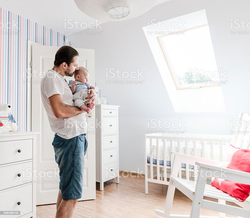 Father looking after his little son, affectionately speaking to him stock photo