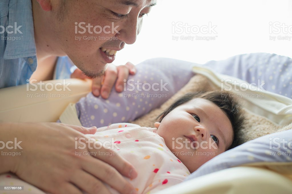 Father loving his baby girl at home stock photo