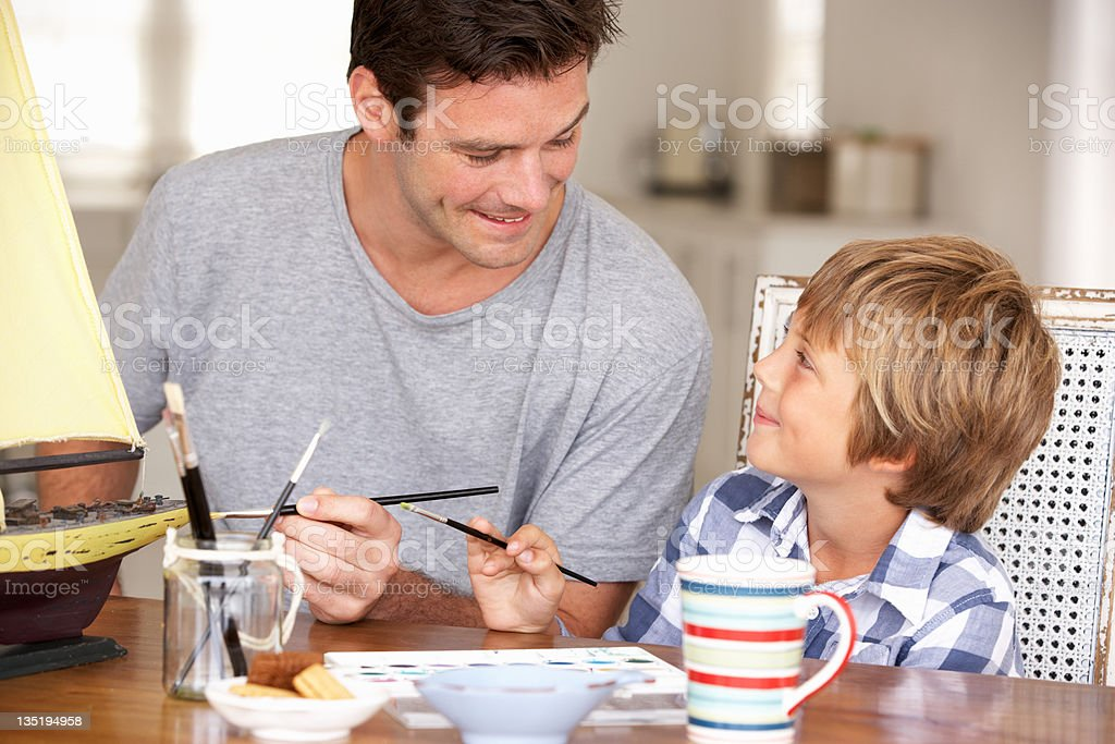 Father model making with son royalty-free stock photo