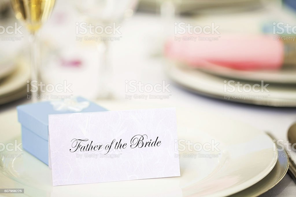 'Father Of The Bride' Card And Wedding Favor On Plate stock photo