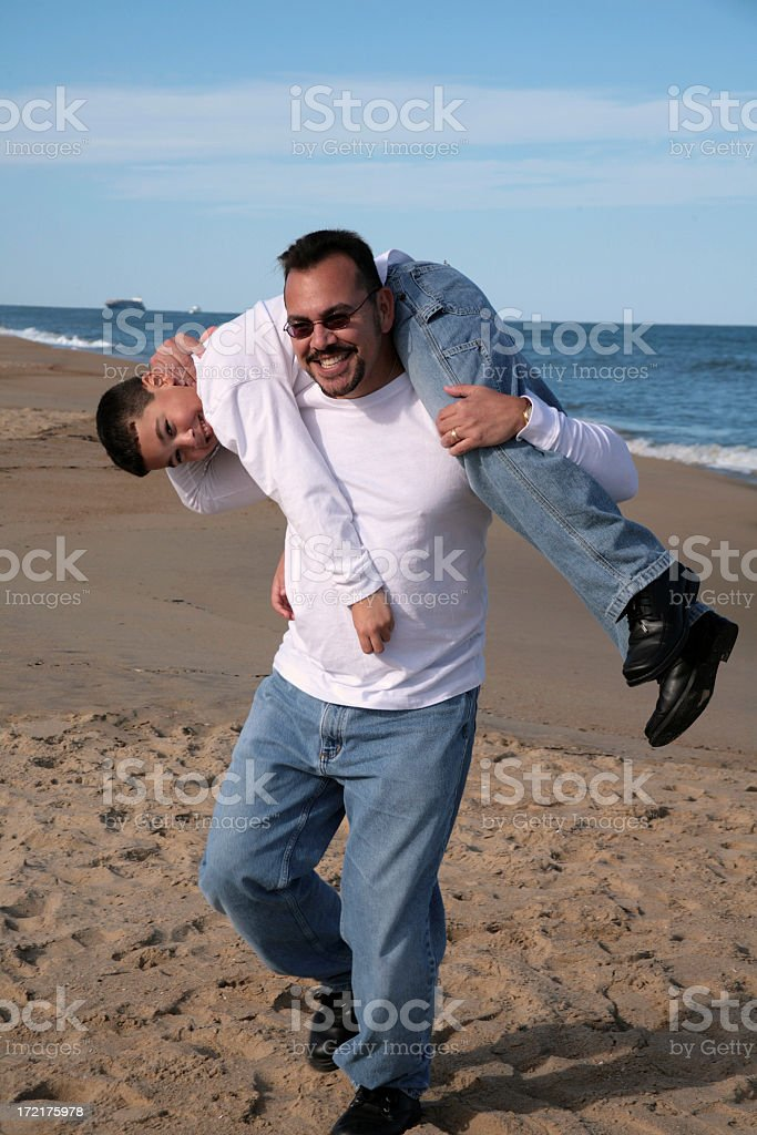 Father on beach with son royalty-free stock photo