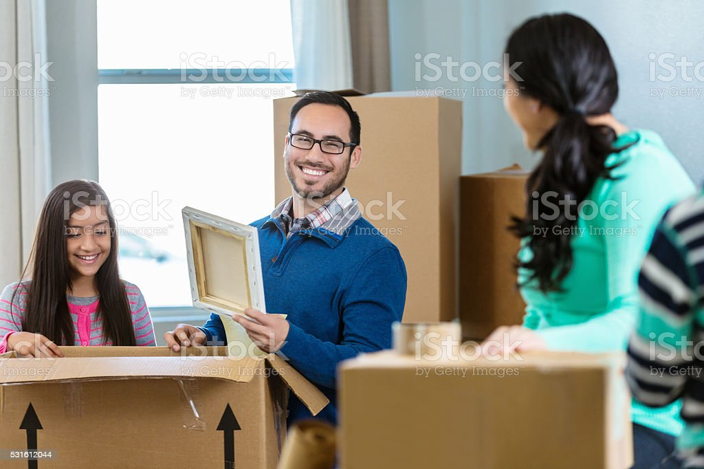 Father packs belongings in box stock photo