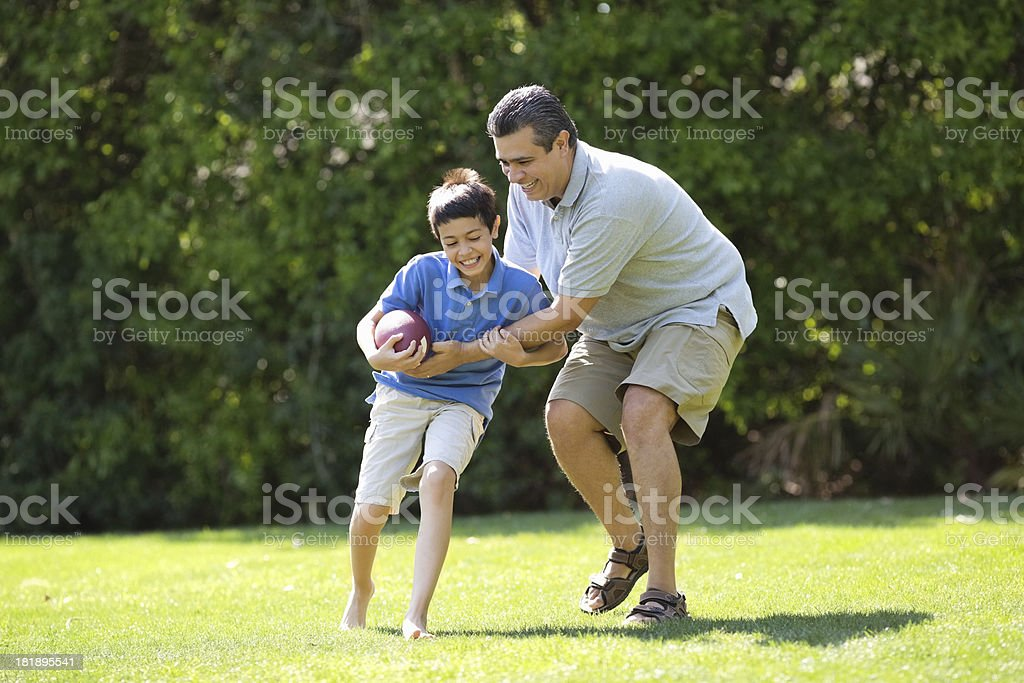 Father Playing American Football With Son royalty-free stock photo