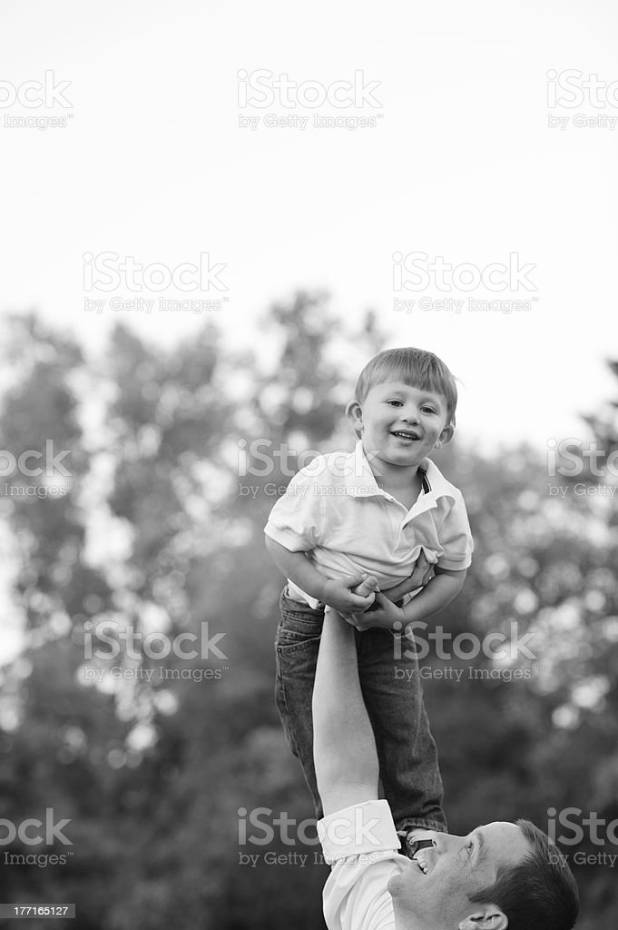 Father Playing Superman with Son royalty-free stock photo