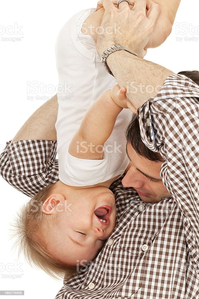 Father Playing With Baby Boy stock photo