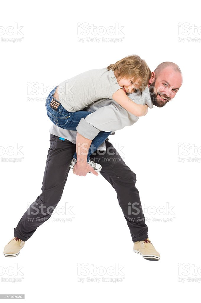 Father playing with daughter stock photo