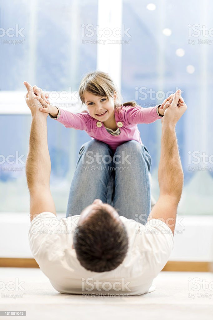 Father playing with his daughter. royalty-free stock photo