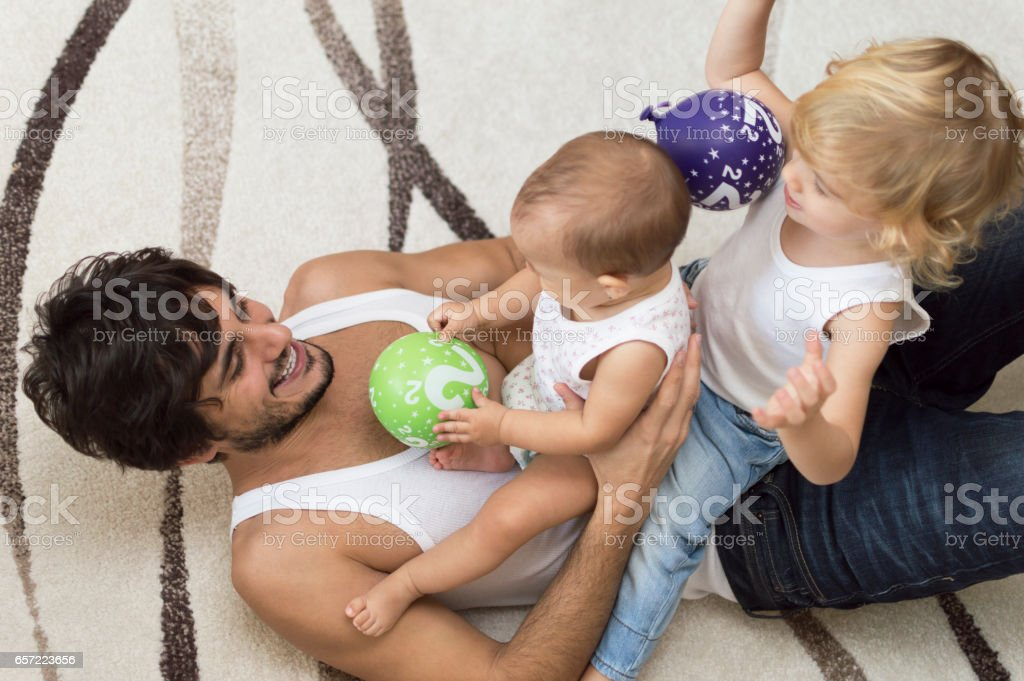 Father playing with his kids stock photo
