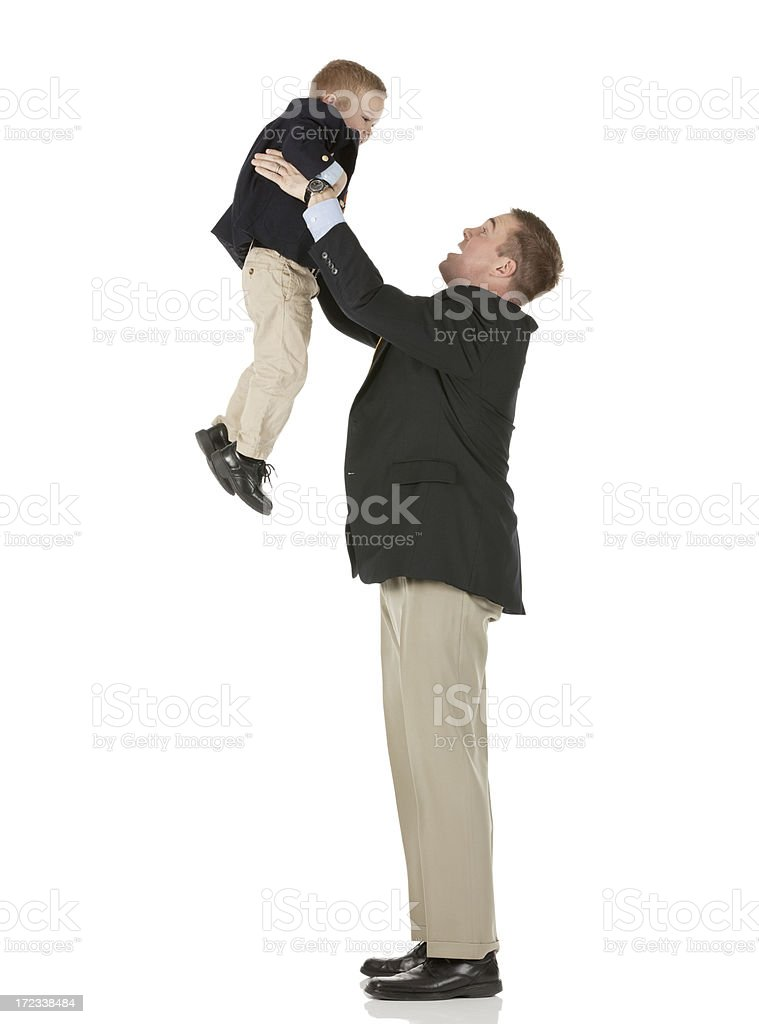 Father playing with his son royalty-free stock photo