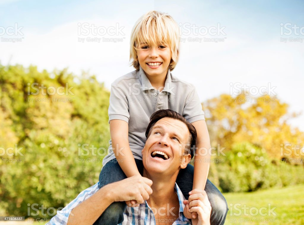 Father playing with son stock photo