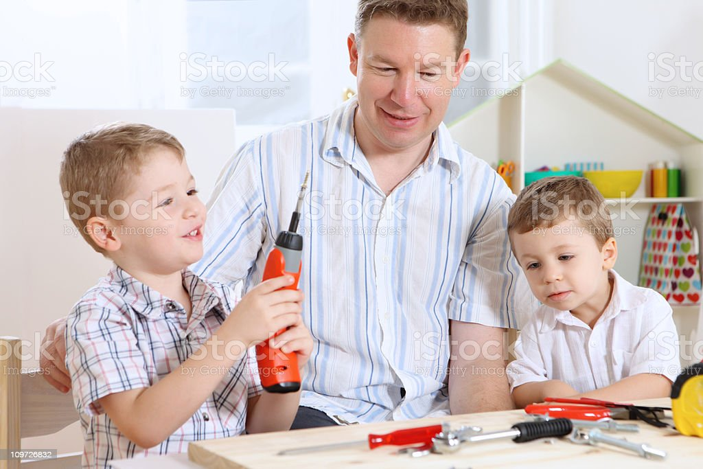 Father playing with two sons royalty-free stock photo
