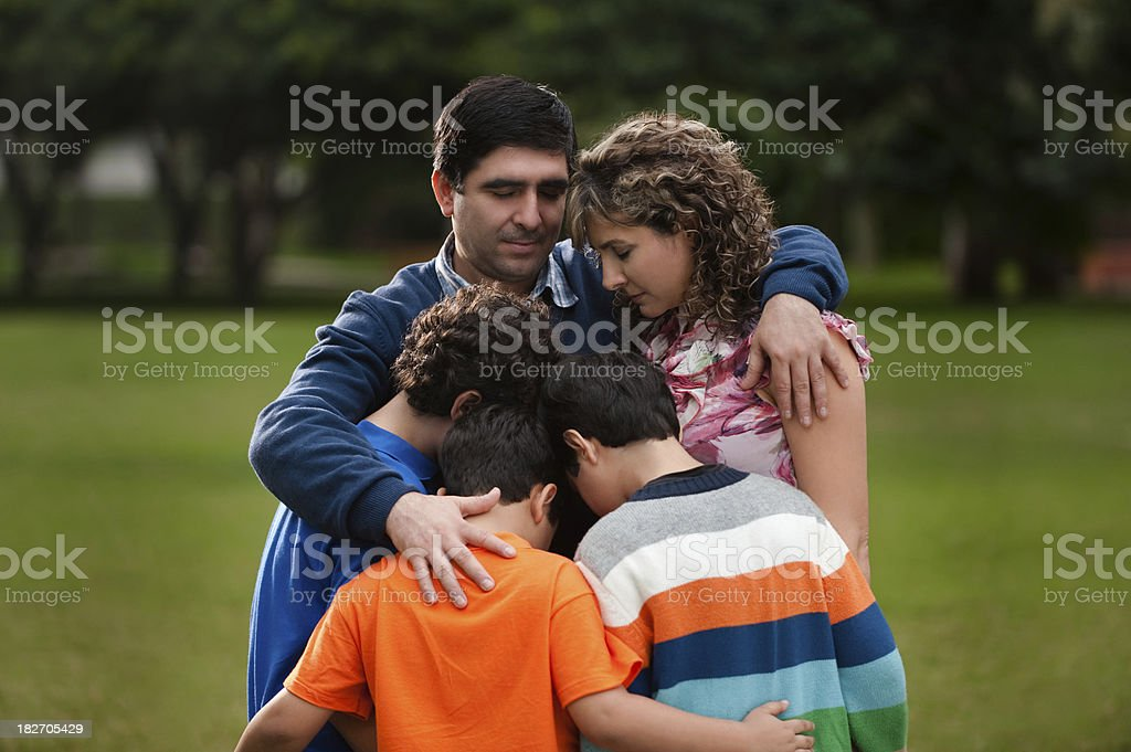 Father protecting his family royalty-free stock photo