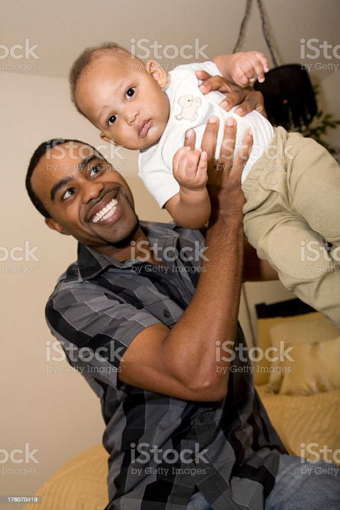 Father Proudly Holding Up His Young Son royalty-free stock photo