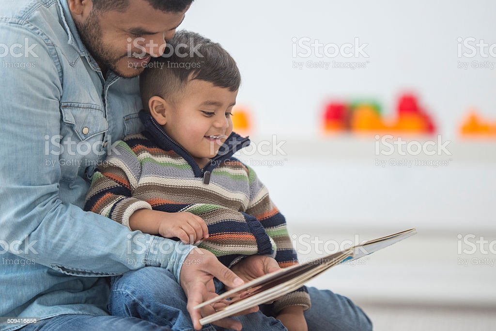 Father Reading His Son a Book stock photo
