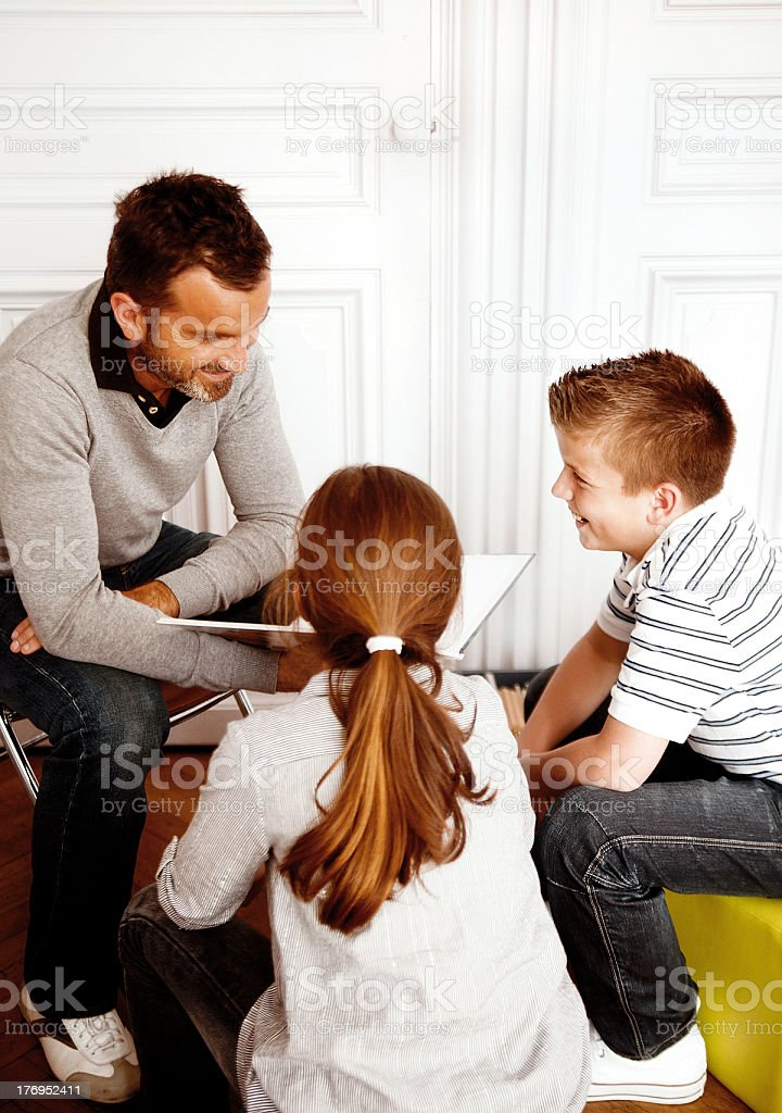 Father reading or teaching stock photo
