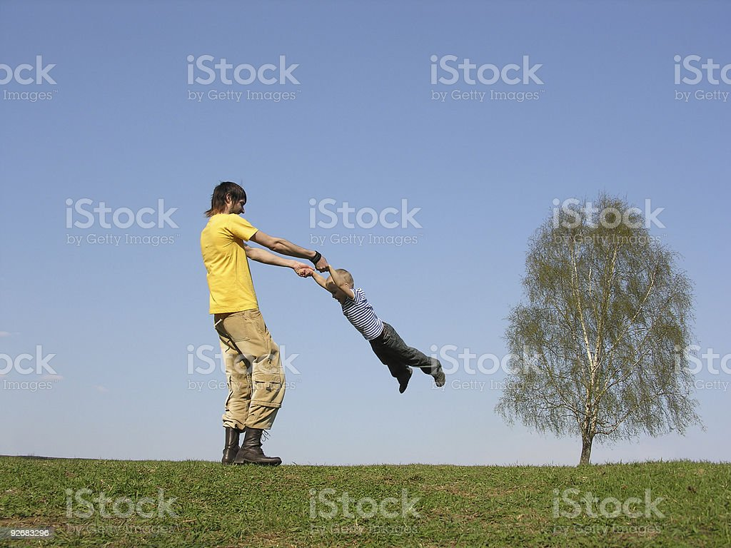 father rotate son royalty-free stock photo