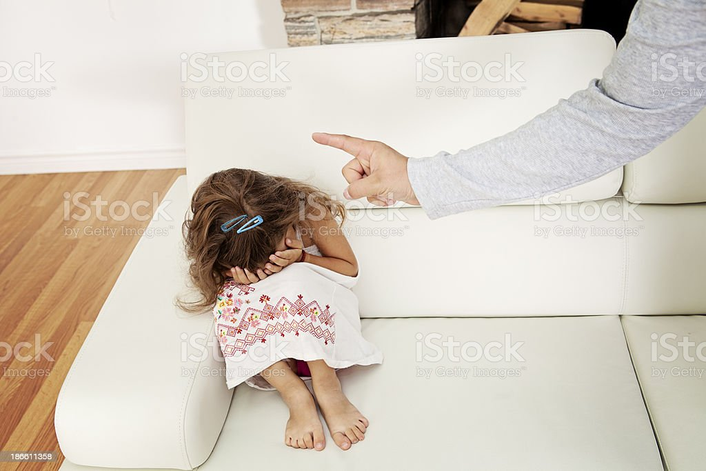 Father scolding daughter royalty-free stock photo