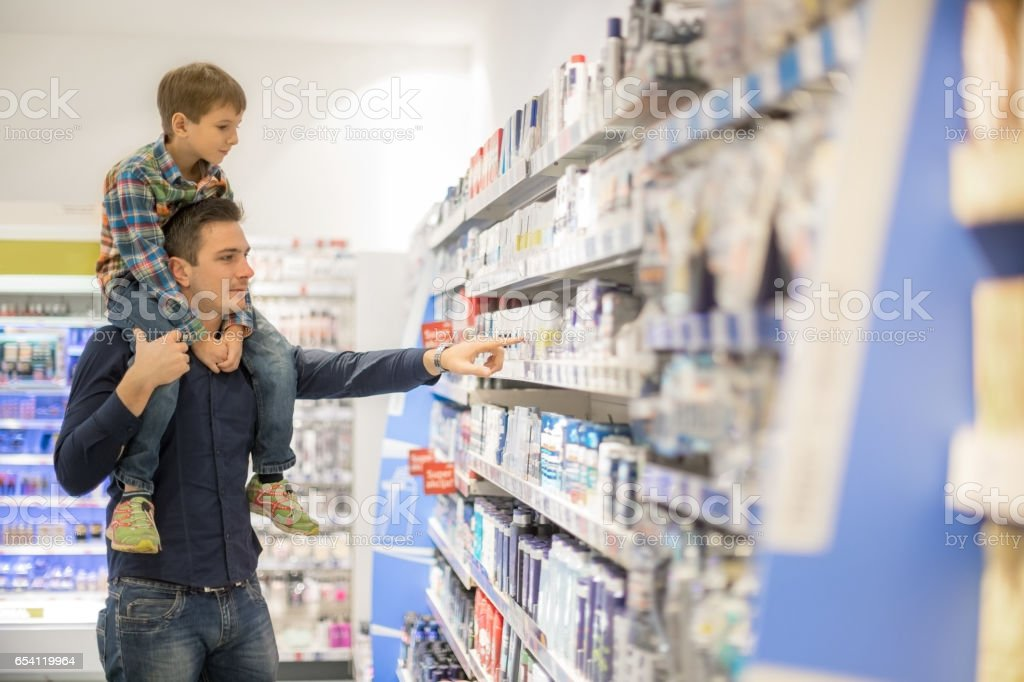 Father shopping with son stock photo