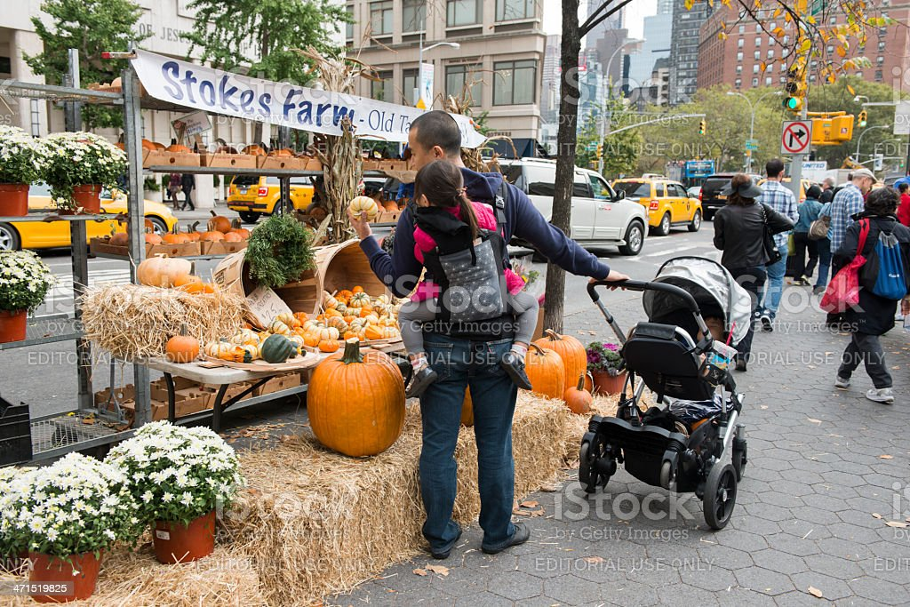 Father Shops at Farmers Market with Kids stock photo