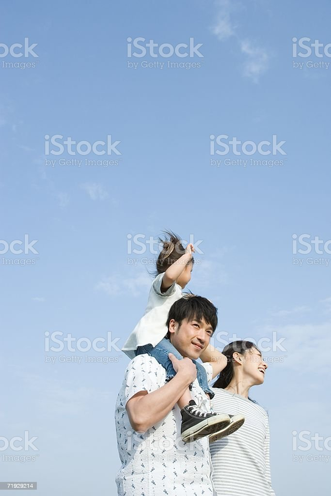 Father shoulder carrying his daughter royalty-free stock photo