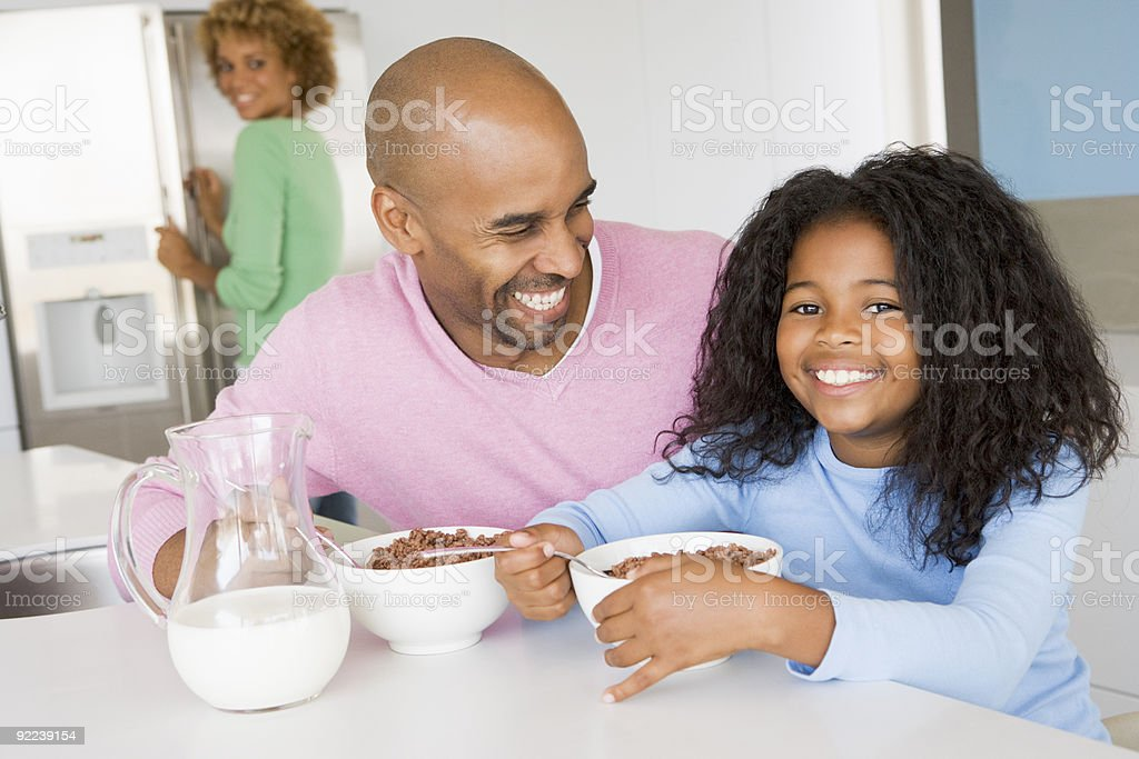 Father Sitting With Daughter They Eat Breakfast royalty-free stock photo