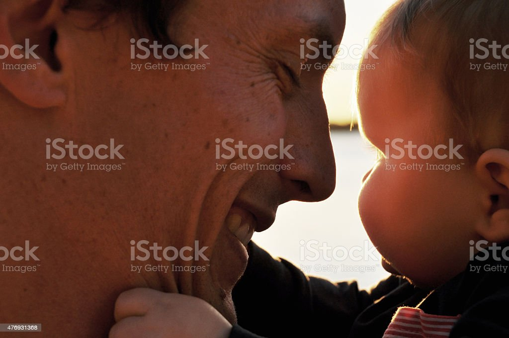 Father smiling at his baby stock photo