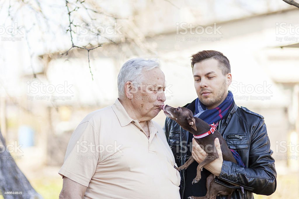 Father, son and little doggy royalty-free stock photo