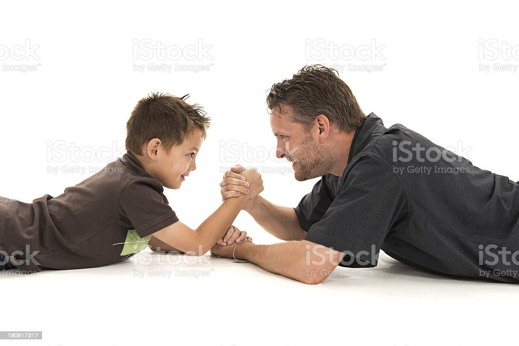 Father Son Arm Wrestle stock photo