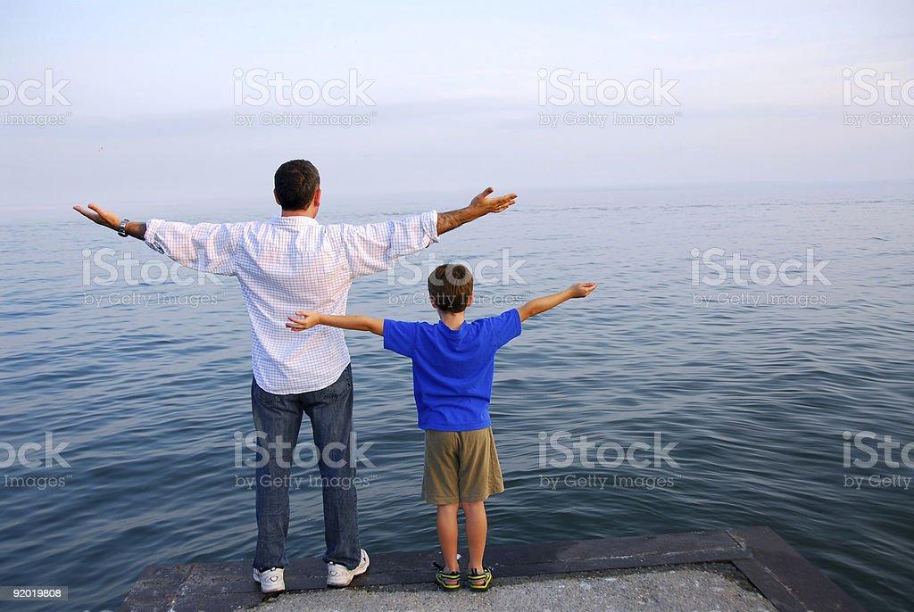 Father son ocean stock photo