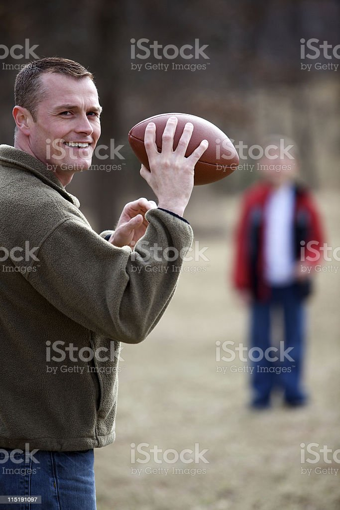 father son outdoor football stock photo