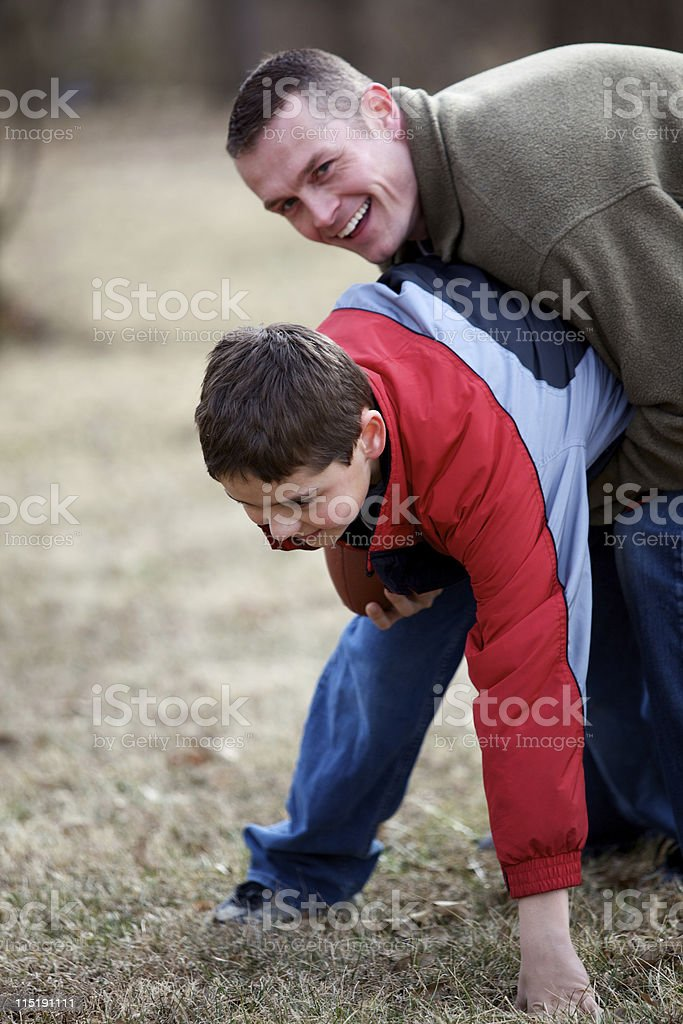 father son outdoor football royalty-free stock photo