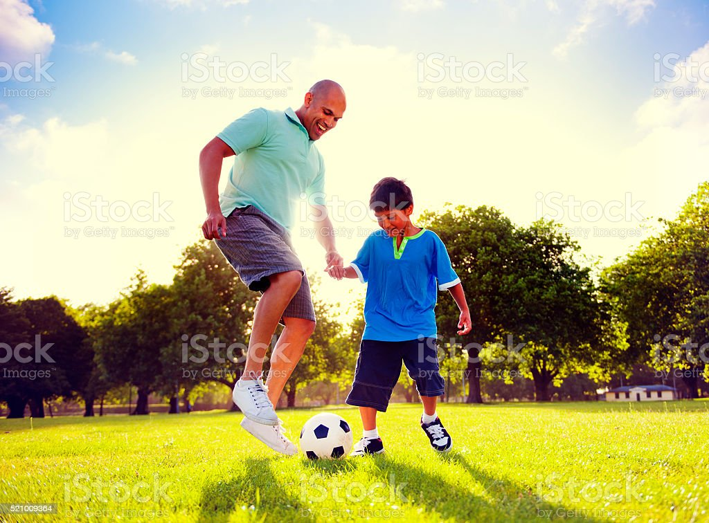 Father Son Playing Soccer Park Summer Concept stock photo
