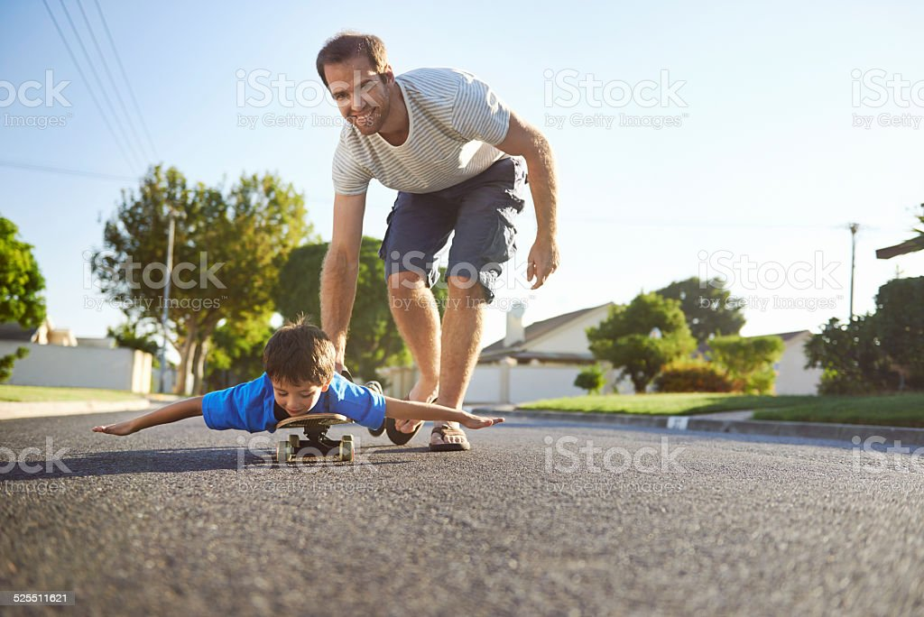 father son skateboard stock photo