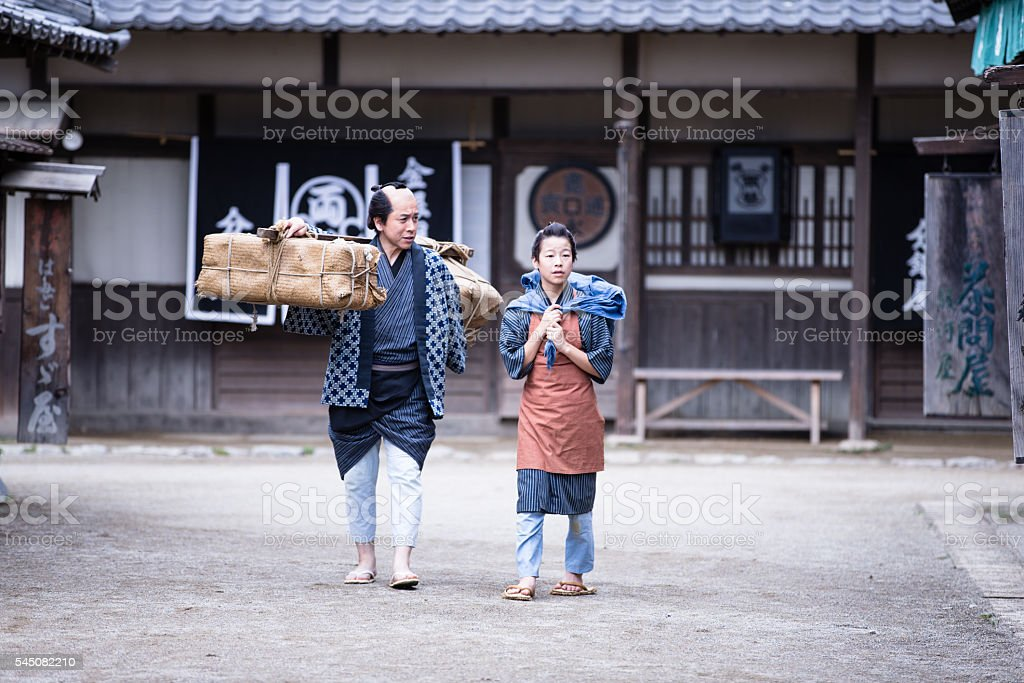Father & Son Walking in a village stock photo