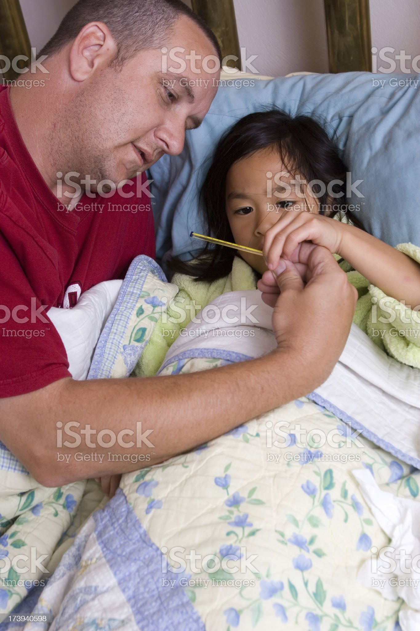 Father taking care of sick daughter series royalty-free stock photo
