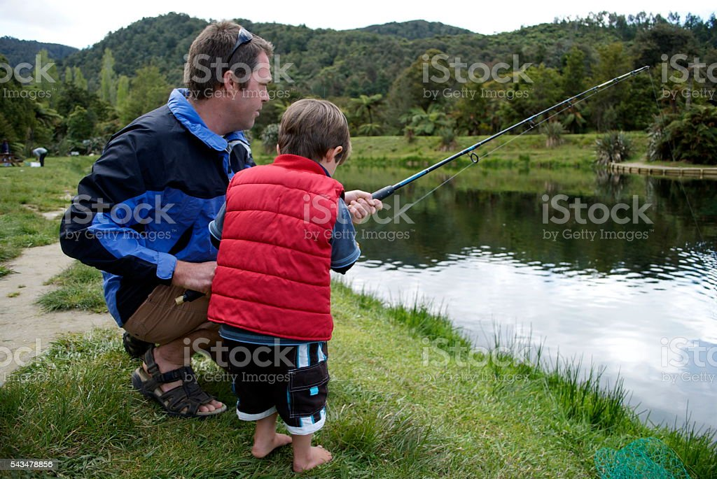 Father Teaches his Toddler to Fish stock photo