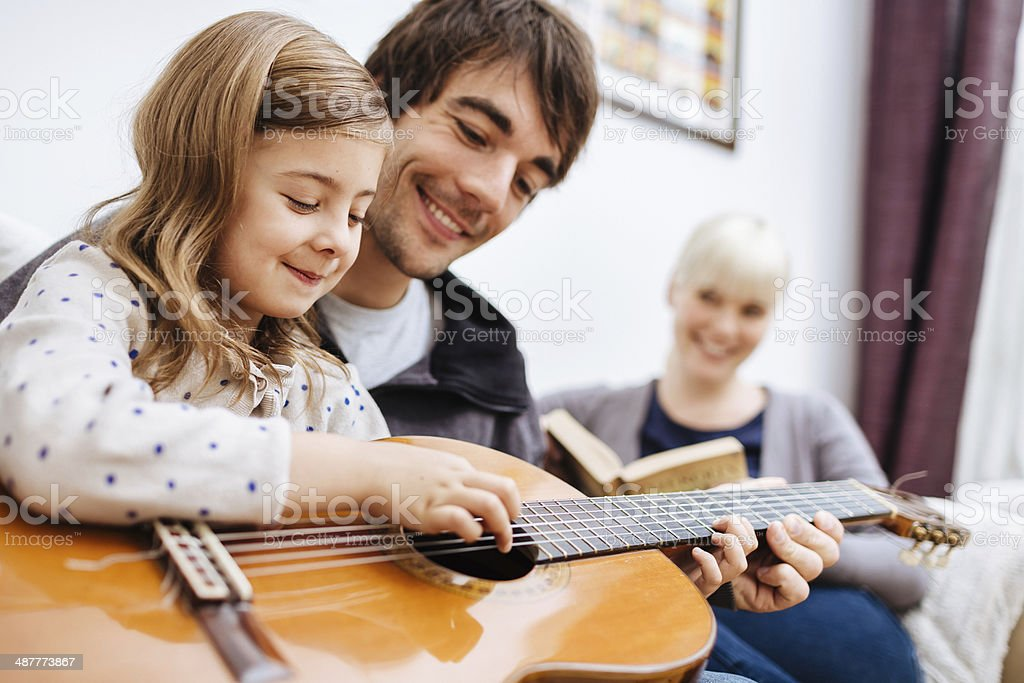 Father Teaching Daughter Guitar stock photo