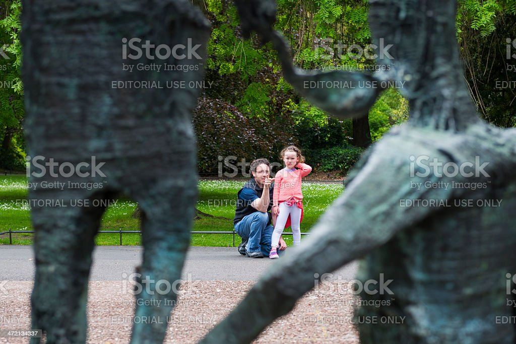 Father teaching daughter in St. Stephen's Green stock photo