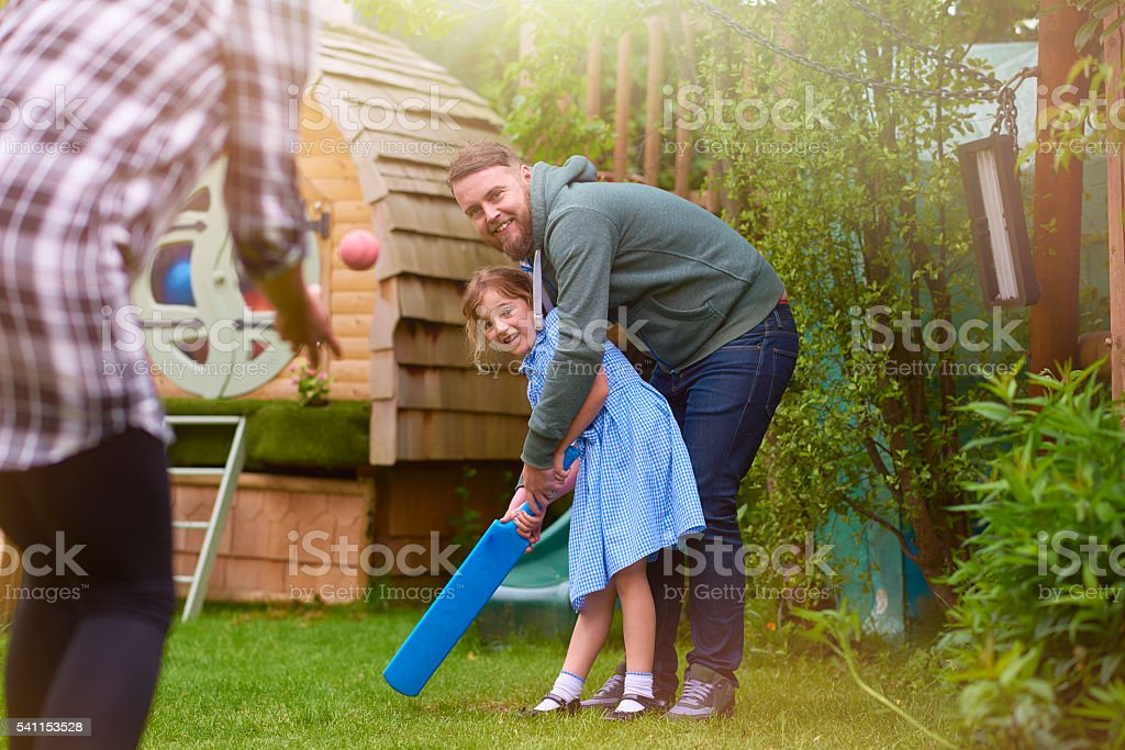 father teaching daughter stock photo