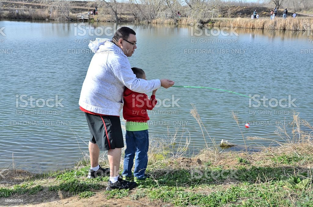 Father teaching his Son how to fish stock photo