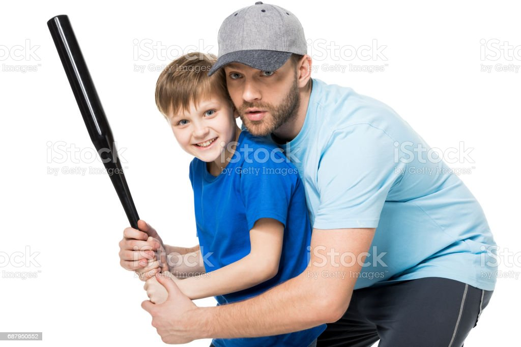 father teaching his son how to play baseball isolated on white stock photo