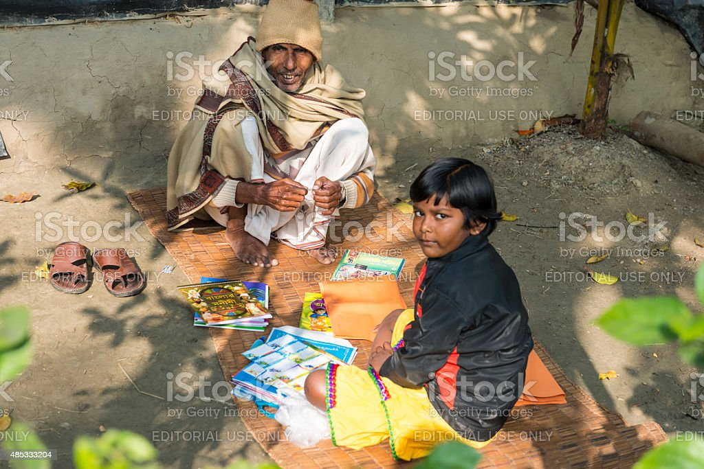 Father teaching his son in India stock photo